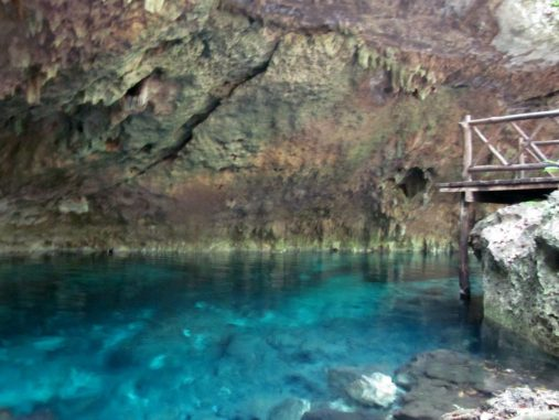Blue waters of a cenote in Tulum, Mexico