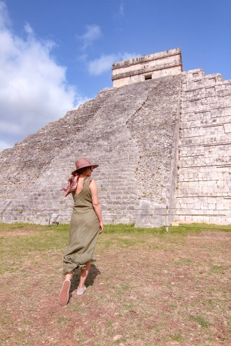 girl in front of chichen itza pyramid