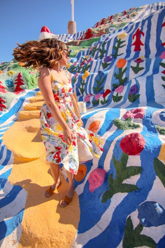 girl flipping hair at salvation mountain