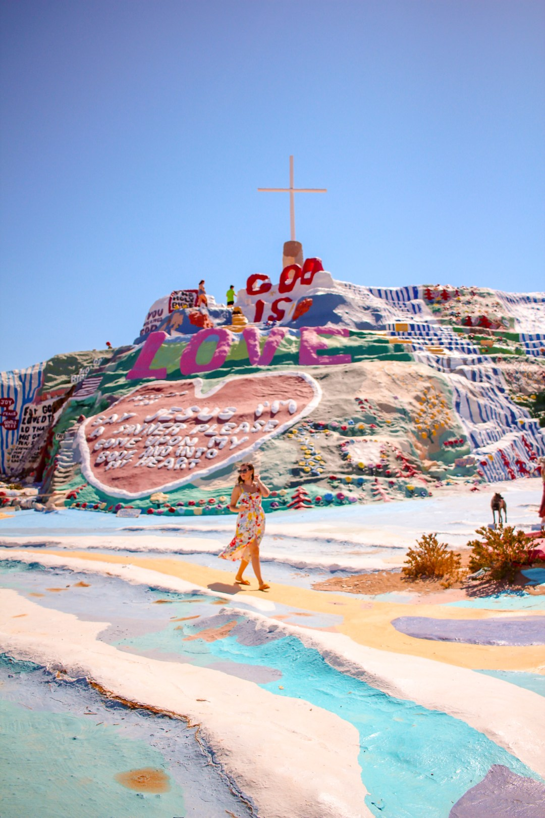 girl in front of salvation mountain an art installation in california
