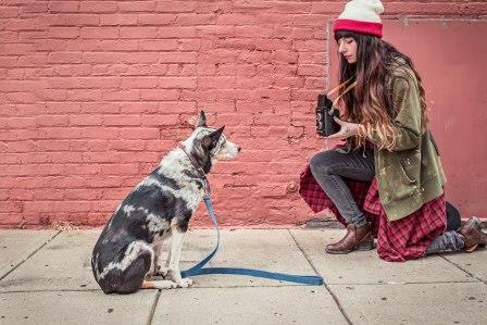 Woman filming dog