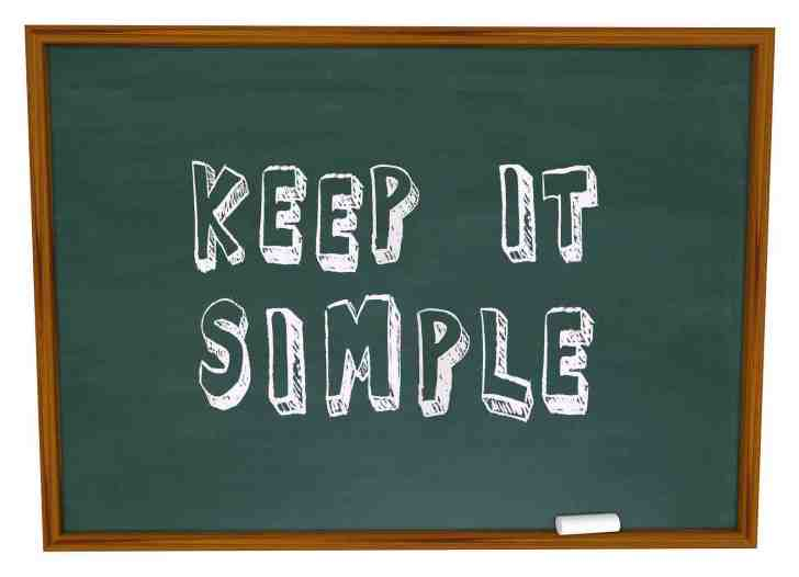 Keep it Simple words written or drawn on a chalkboard to illustrate the need to aim for simplicity t