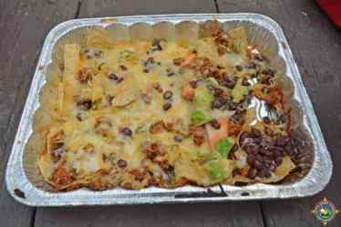 grilled nachos in a foil pan