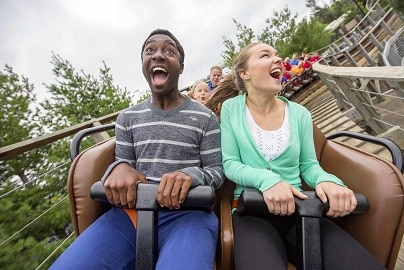 happy kids on rollercoaster