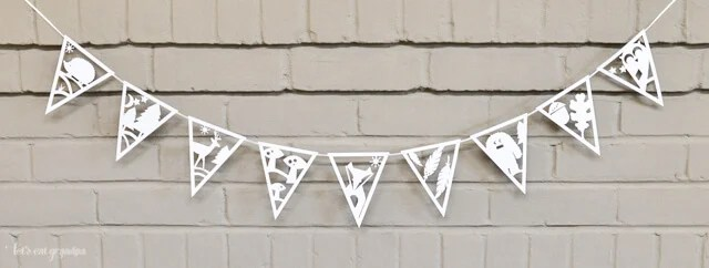 Use your Cricut or other electronic cutting machine to make this DIY paper banner with adorable woodland creatures! Perfect for woodland parties, baby showers, and more!