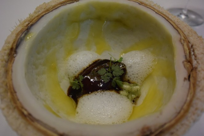 Thrush cooked in his own sauce with coconut rice, galanga, keffir lime, and tomburi with lemon puree