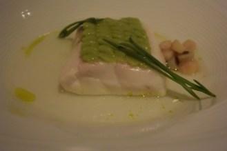 Sea bass with smoked avocado, pitachio oil, lime zest and dashi.