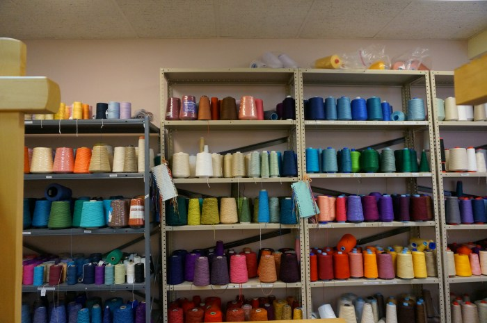 A rainbow of colored yarns.