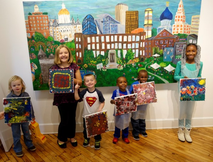 Children from Mommy/Daddy & Me painting class pose in front of The Hartbeat, 2014.