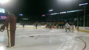 Denver practicing on the ice under the lights at Coors Field