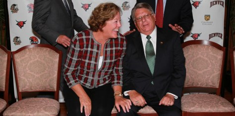 Former University of Denver athletic director Peg Bradley-Doppes and former UND athletic director Brian Faison share a laugh at the NCHC's introductory press conference in July 2011.