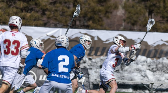 Pioneers' rally falls short as Denver falls to Duke 15-13 in home opener