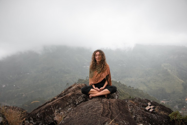 woman breathing on mountain