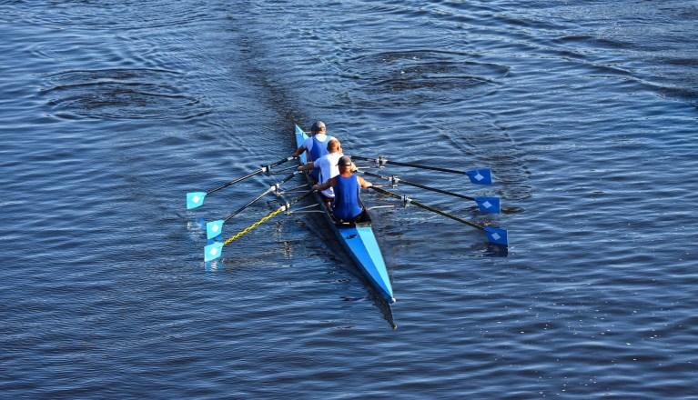 3 people in a kayak