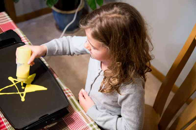Simple Holiday Traditions: Making Christmas Pancake Art *This looks so fun, my kids would love it.