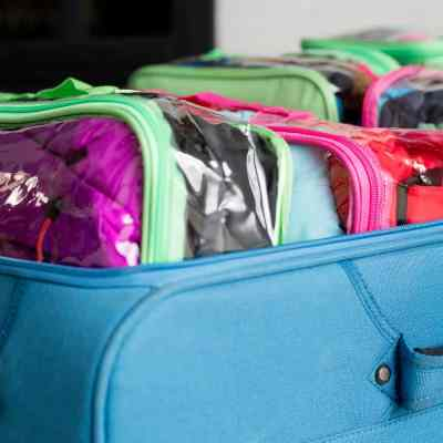 The Best Way To Pack a Suitcase: How to Travel With a Family + a Single Suitcase