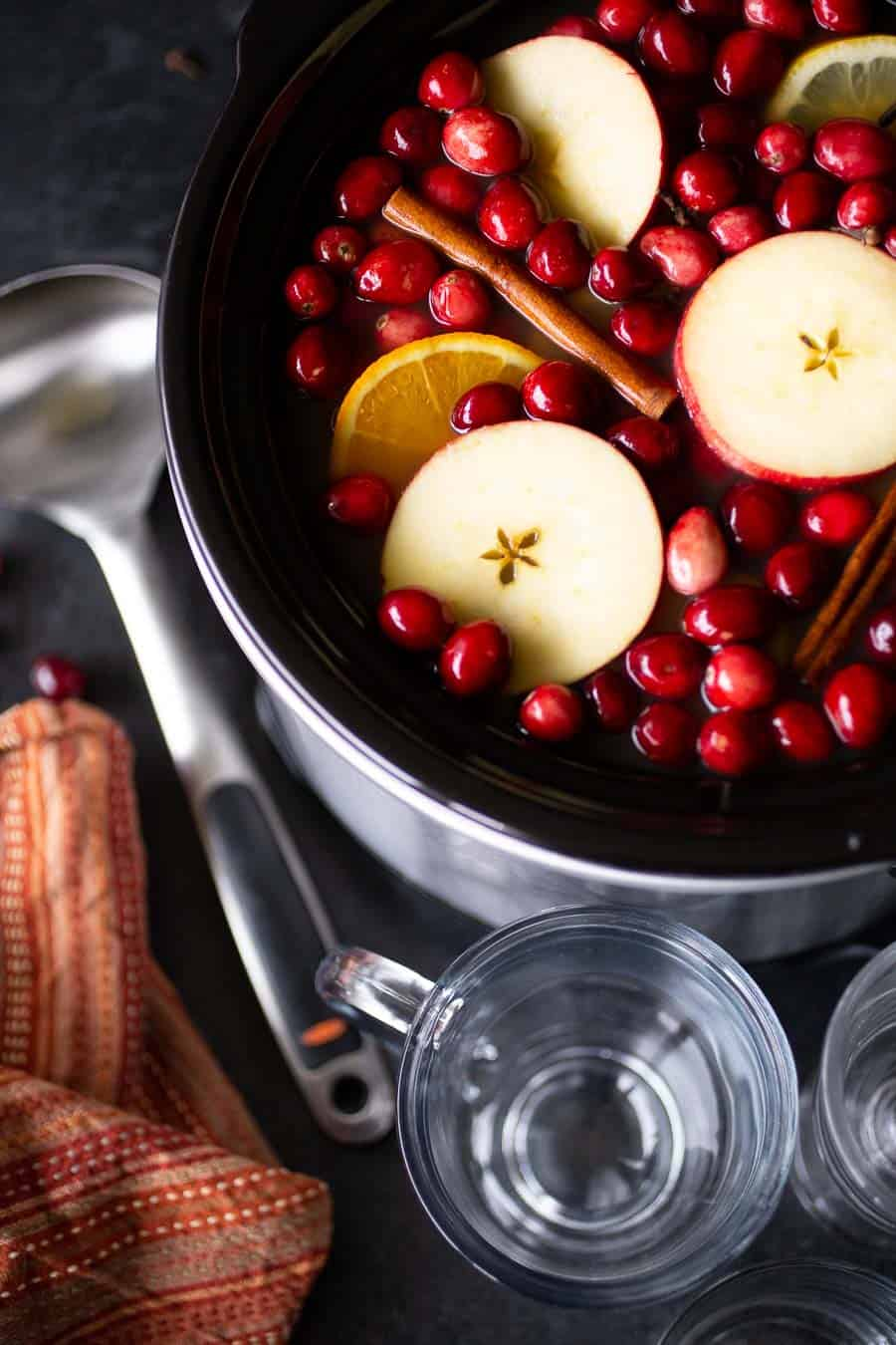Using a slow cooker for this classic cold-weather mulled cider recipe allows you to prep, pre-make, and thenbe fully present with your family and friends. The slow cooker keeps the hot apple cider warm (and mulling) in the background while you get to sit back and enjoy some downtime with the people you love. #mulledcider #applecider #fallrecipes #thanksgivingrecipes #christmasdrinks #crockpotrecipes #slowcooker #slowcookerrecipes #recipes #drinkrecipes #easypeasydrinks #cider #mulledcider #applecider *My family LOVES this cider