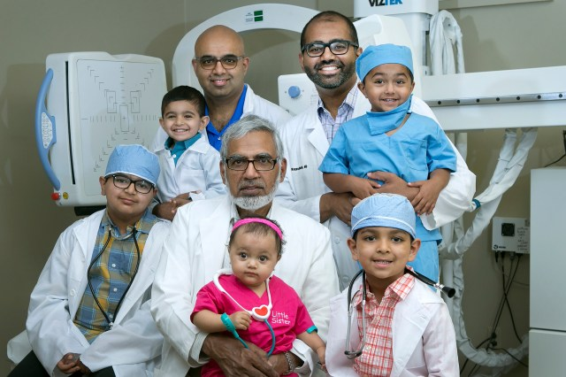 Suleman Hussain, MD (Orthopedic Surgeon at ORA Orthopedics ~ Bettendorf Office) Munawar Hussain, MD (OB-GYN ~ Private Practice in East Moline, IL) Waqas Hussain, MD (Orthopedic Surgeon at ORA Orthopedics ~ Moline Office) holding Humza Hussain (his son)