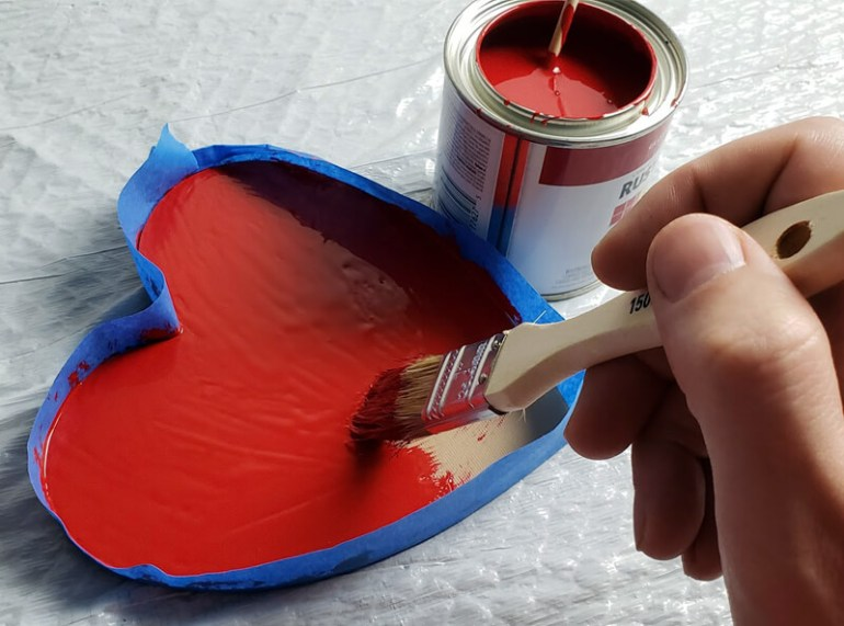Painting an enamel adhesive base for flock