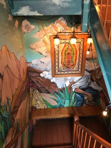 Heading down the steps into Casa Reyna's restaurant space