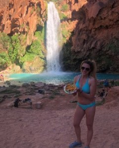 Me in front of the waterfall with a taco.