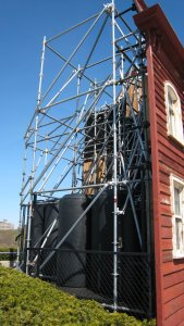 Cornelia Parker's Transitional Object (PsychoBarn), view of the back showing scaffolding and water tanks used for ballast.