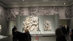 Sections of the Telephos Frieze from the Great Altar of Pergamon, 2nd century B.C., in the foreground (Herakles Finding Telephos n the right), with, high in the background, photographs of some of the most central images from the frieze.