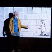 Andrew Dawson with Gorey's Doubt, and the play's backdrop of Gorey's notes and ideas in Travis Russ's GOREY The Secret Lives of EdwardGorey