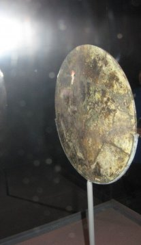 Mirror, detail showing once reflective face.