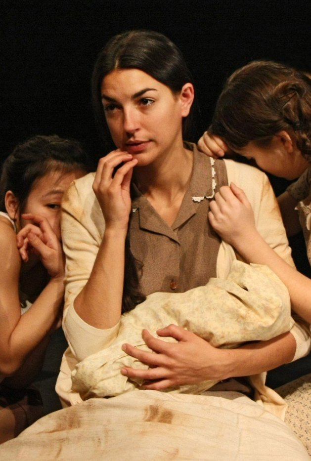 Mother and infant in <em>Decade at a Glance</em>, photo courtesy of Stella Adler Studio of Acting and The Harold Clurman Center for New Works in Movement and Dance Theatre<