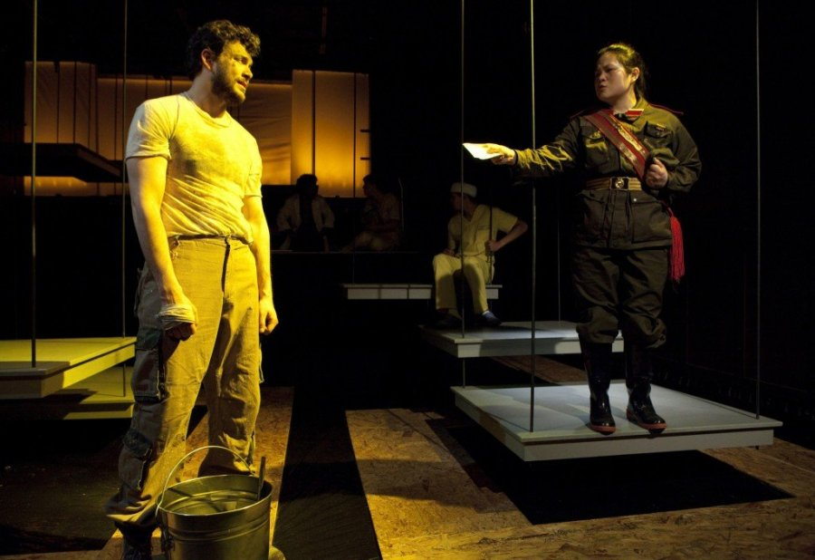 Future Anxiety   Raul Sigmund Julia as Malcolm sets down his heavy bucket for a moment as Holly Chou as Comrade Li profers a creation. Photo: Richarde Termine