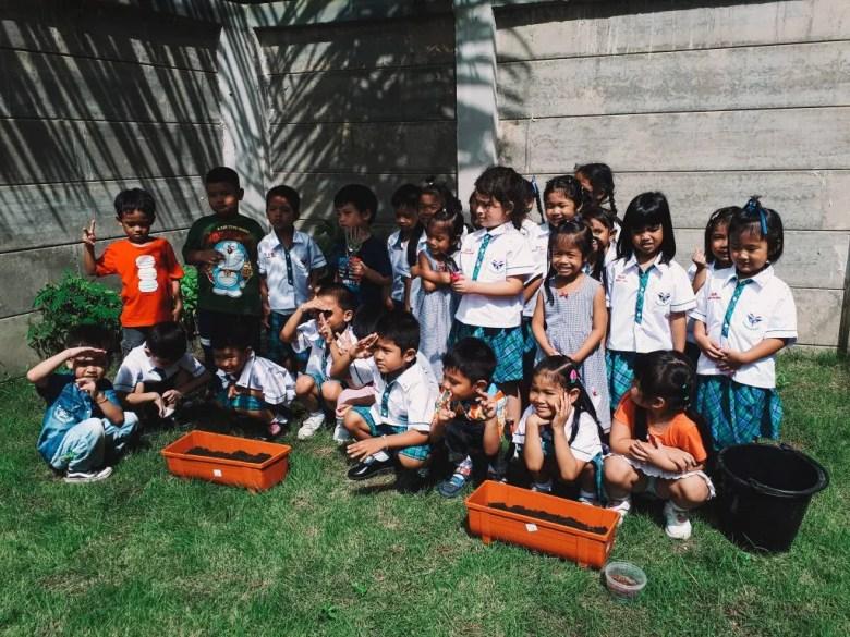 Kindergarten class planting seeds in the garden