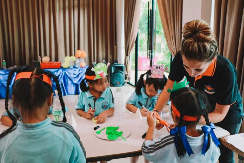Teaching English camp in Thailand doing fun science experiments.
