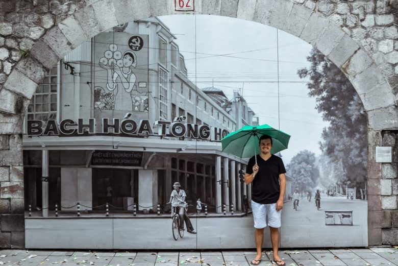 Jonathan standing in front of a beautiful street mural in Vietnam