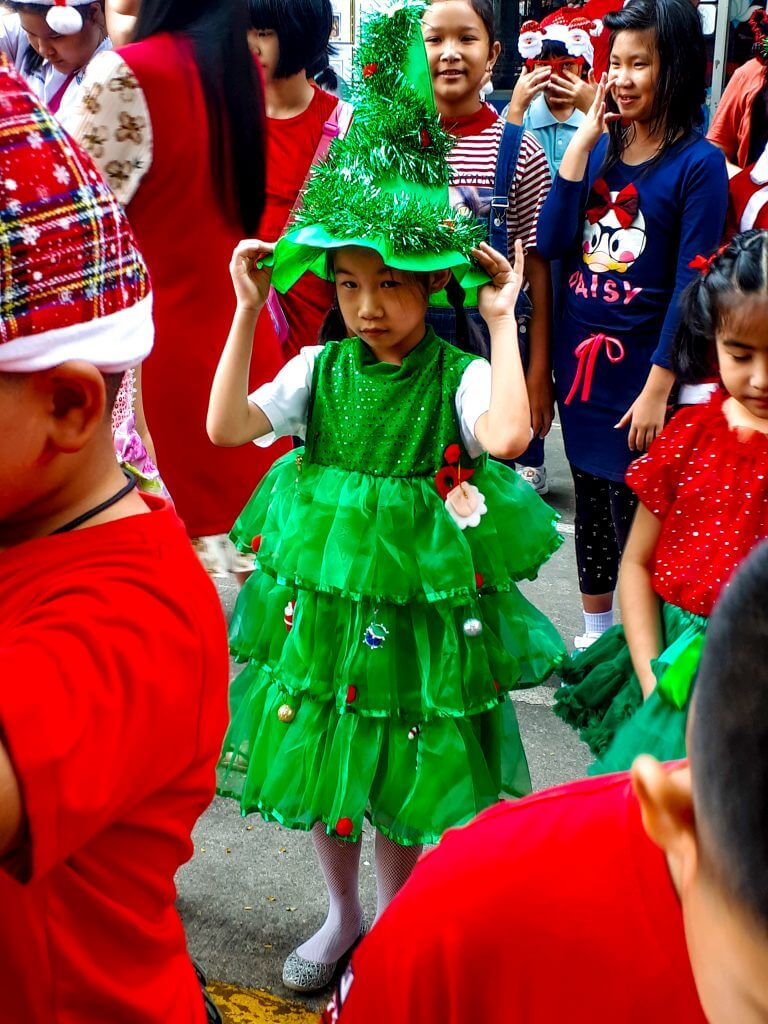 Children in Thailand dressing up in Christmas outfits