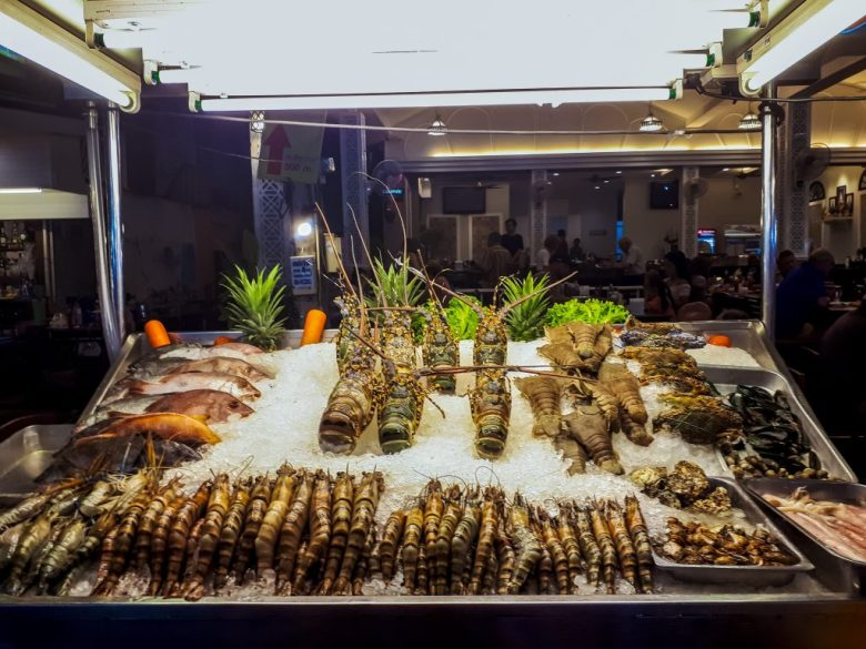 a seafood stand at a market in Thailand
