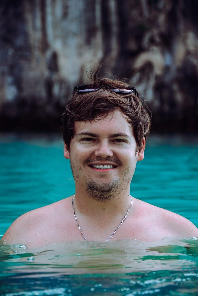 Jonathan in the crystal clear blue water surrounded by beautiful limestone mountains at Hong island in Krabi ,Thailand