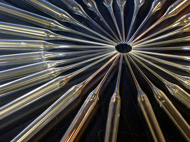 Shiny glass Pasteur pipettes arranged in a circle like spokes in a wheel BRCA