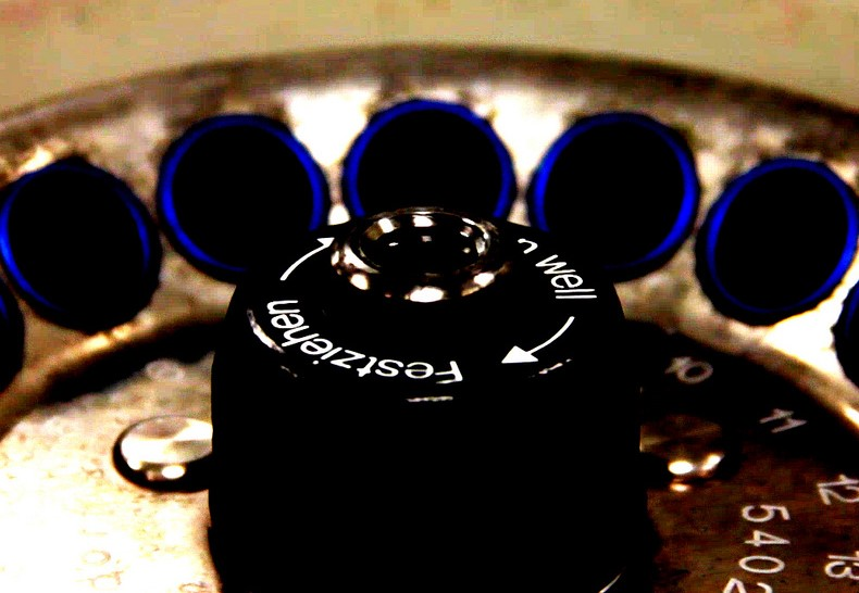 Close-up image of the top of a centrifuge, over the central axis