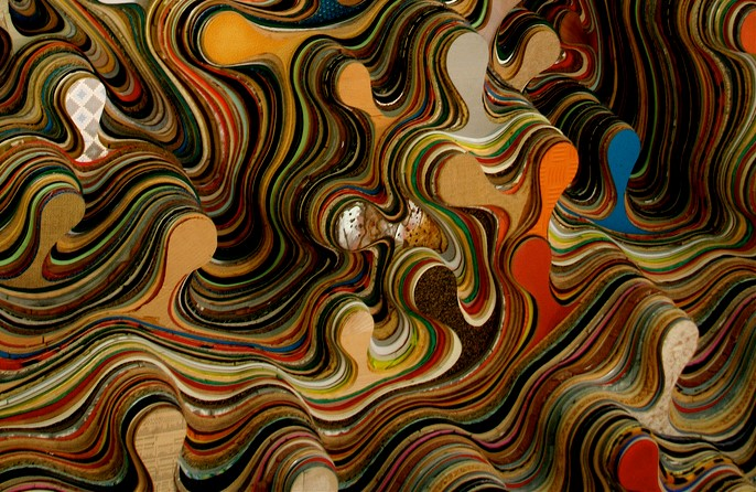 abstract image of layers of colored wavy shapes, with blobs sticking out in blue, orange, red, shades of tan, brown, and patterns.