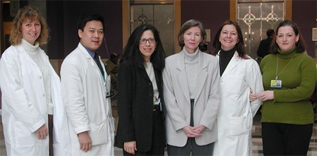 Pancreatic cancer survivor Kathleen Dowell, center right, with her treatment team including Dr. Elizabeth Jaffee (center left)
