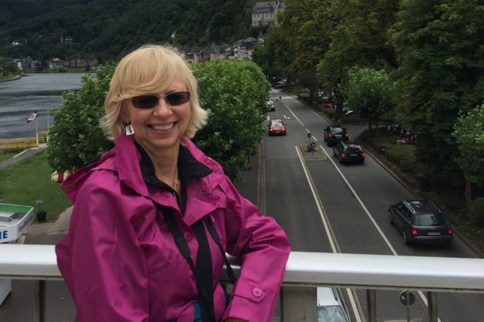 Roxanne Waling, five-year pancreatic cancer survivor posing on her river cruise through Europe.