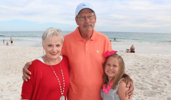 Kayi Lewis, her husband Ron Lewis, and granddaughter at the beach