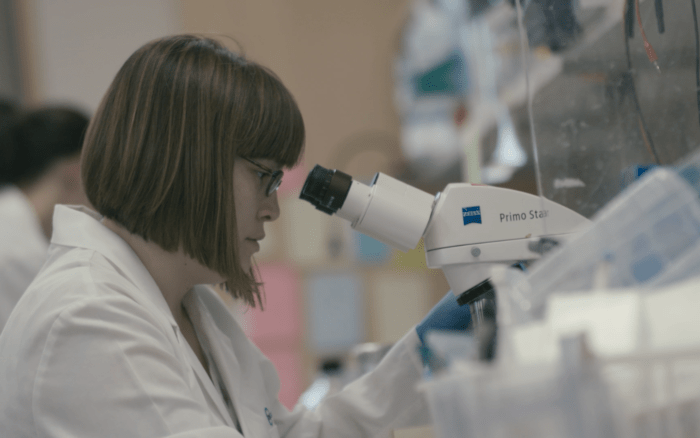 Dr. Dannielle Engle at the microsope in her lab