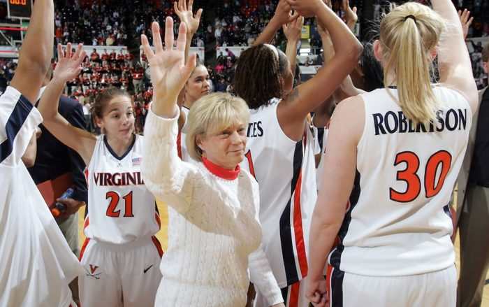 UVa head coach Debbie Ryan waves to the crowd alongside her team after beating Clemson 2-26-06.