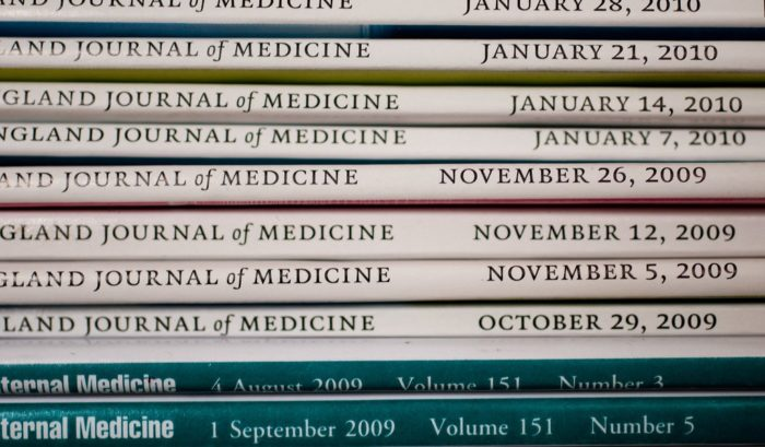 Stack of medical journals laying on their sides