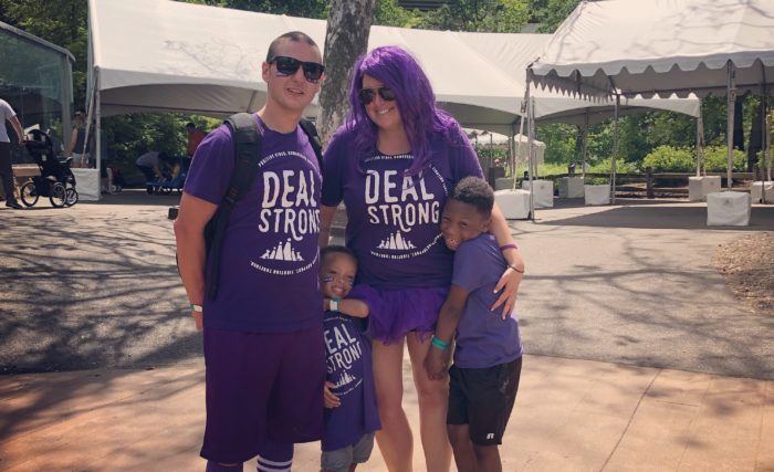 Adam Deal and his family in purple for a pancreatic cancer awareness event