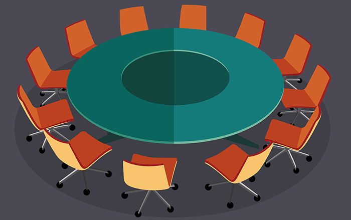 illustration of a green round table with orange chairs