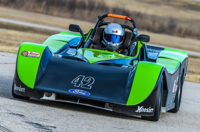 Pancreatic cancer patient Eric Lasner racing in a green and blue car