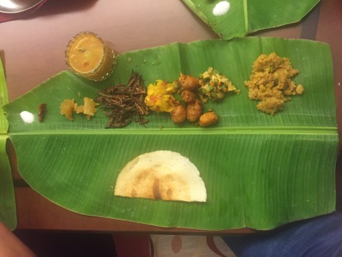Banana leaf with indian dinner dishes